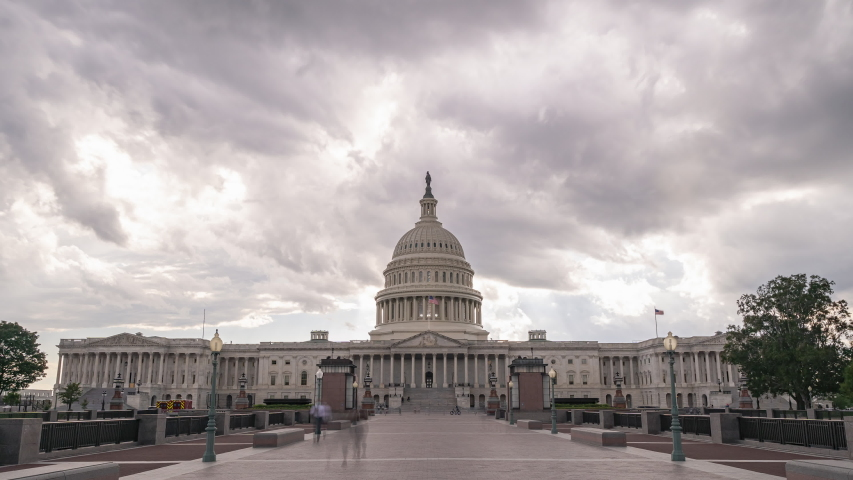 A timelapse of the U.S. Capital with dramatic clouds above.
