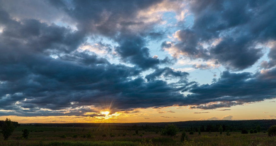 4K Time lapse, beautiful sky with dark blue clouds background, Clouds at sunset. Sky with clouds, weather, nature, cloud blue, the rays of the sun shine through the clouds Royalty-Free Stock Footage #1056999140