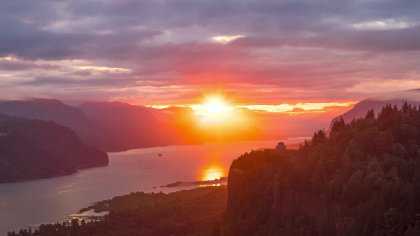 Breathtaking and spectacular nature sunrise in the Columbia River Gorge with Vista House at the Crown Point situated on the edge of a steep rock. Beautiful, peaceful and scenic nature timelapse.
