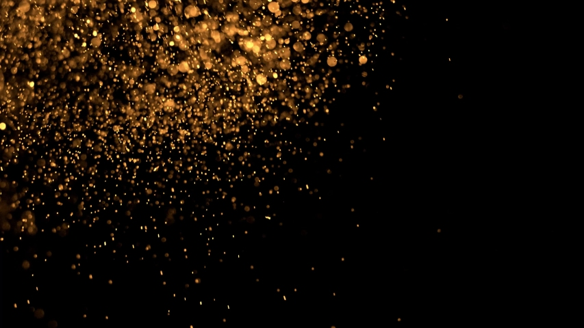Golden Glitter Sparkling Magic light. Shining gold Dust particles Trail Crossing sparkles on black background 4K. Birthday, Anniversary, new year, event, Christmas, Festival, Diwali. | Shutterstock HD Video #1057002491