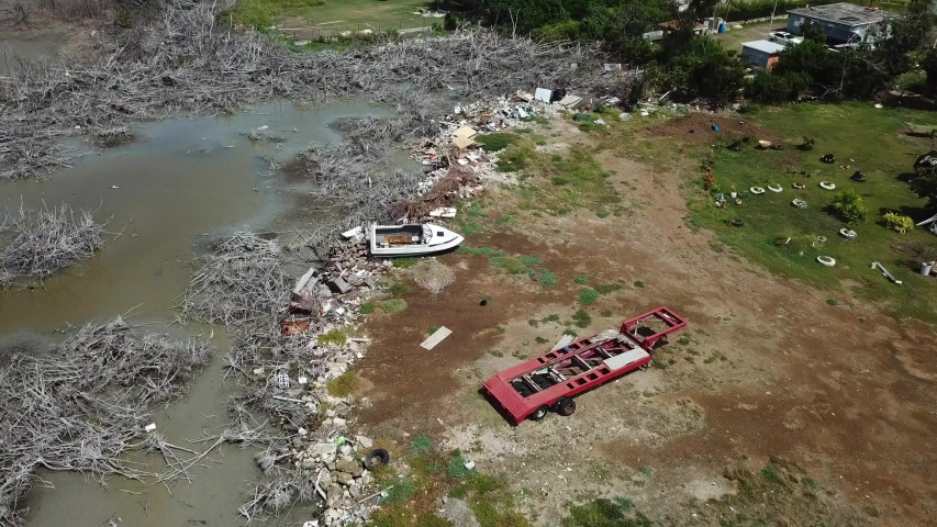 Boat Wreck and Trash on Lagoon Coast of Puerto Rico, Aftermath of Hurricane Disaster, Aerial View