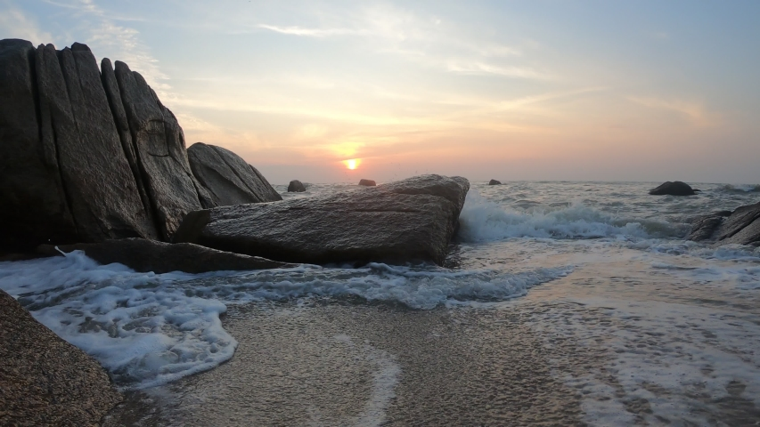4K Footage of Sunrise and smooth waves movement at Teluk Cempedak Beach, Kuantan, Pahang. Low light clip.