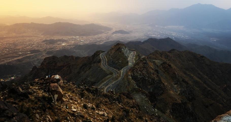 Traffic light trails wrapped around mountain on the zig zag road in Al Hada, Taif region of Saudi Arabia