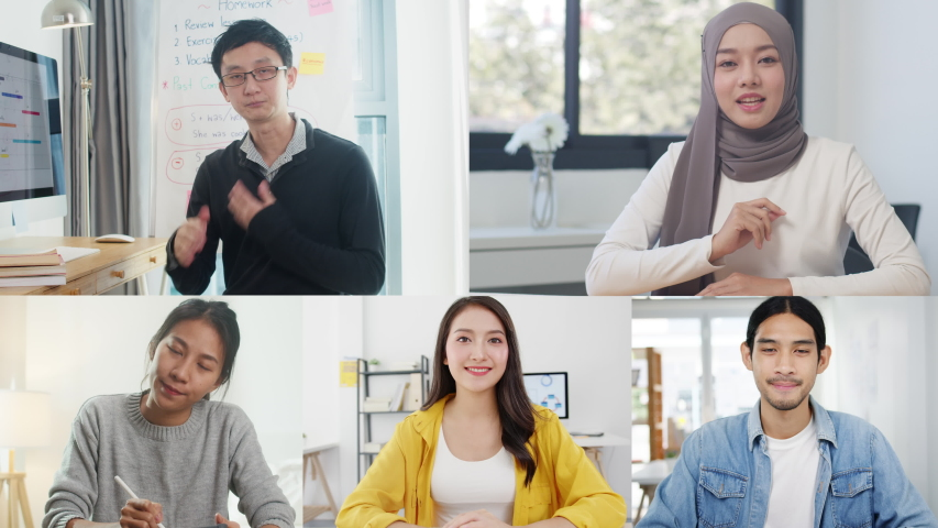 Asia businessmen and businesswomen user interface of business team talk by video call brainstorm online meeting while use laptop work remotely from home. Social distancing, quarantine for corona virus Royalty-Free Stock Footage #1057028558