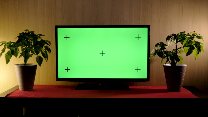 TV with green screen composited. TV or television - green screen - room - on the table.  | Shutterstock HD Video #1057046264