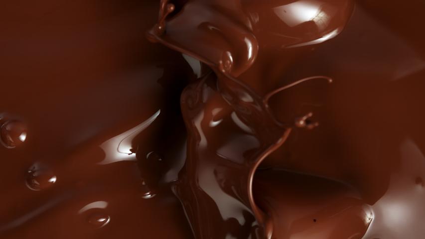 Super Slow Motion Shot of Splashing Melted Chocolate Background at 1000fps.
