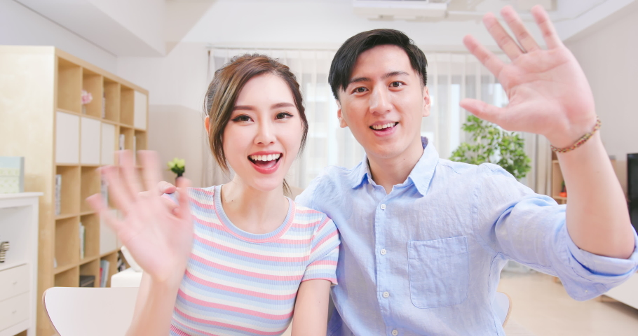 Asian young couple have video chat with computer at home happily