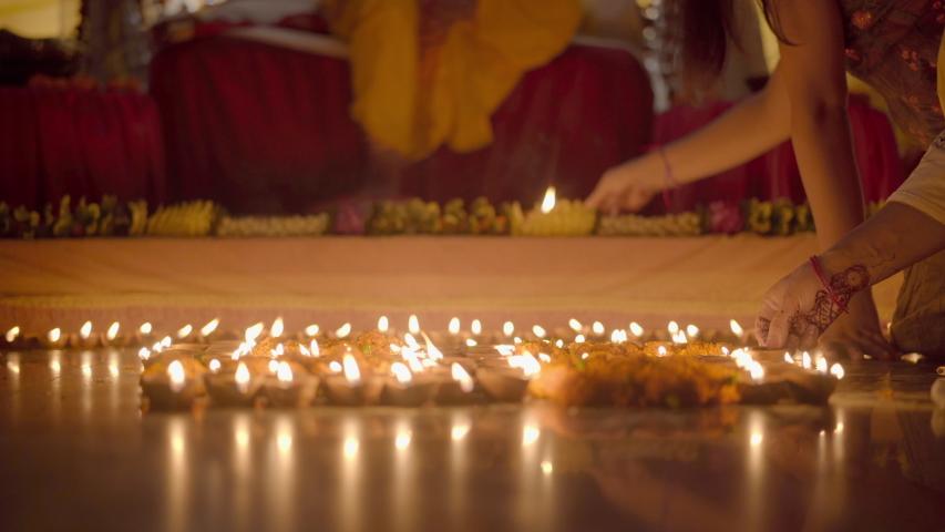 Lighting Diyas at Home. Celebrating Indian festival. Celebration Ram Mandir construction. Apple prores 422 4k Royalty-Free Stock Footage #1057066478