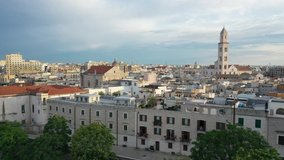 Beautiful panoramic aerial 4K video from flying drone at sunset to Bari old town ,Cathedral Saint Sabino ,San Nicola Basilica and Normanno Svevo Castle in summer evening. Bari ,Apulia, Italy (Series)