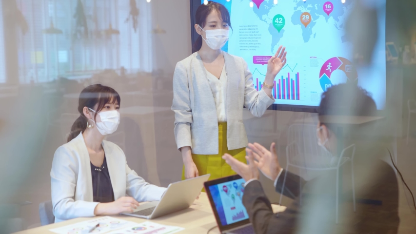 Group of businessperson meeting in the office with surgical mask. Royalty-Free Stock Footage #1057070915