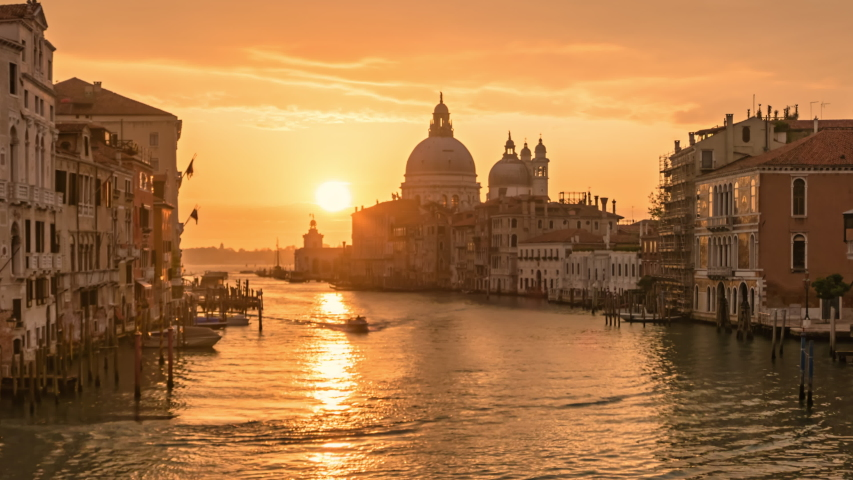 Time lapse Sun rising over of Grand Canal traffic and Basilica di Santa Maria della Salute, view from Accademia bridge, Venice, Italy Royalty-Free Stock Footage #1057108295