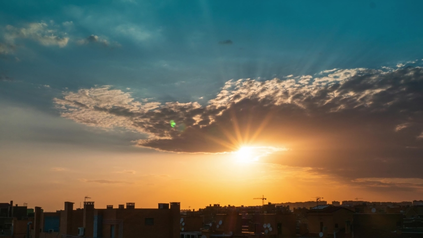 Timelapse of sunset over Vallecas city with few clouds in the sky and orange teal tones.  | Shutterstock HD Video #1057123628