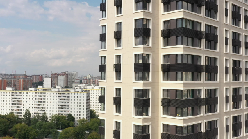 New modern black and white apartment building in the modern metropolis. In summer, aerial view