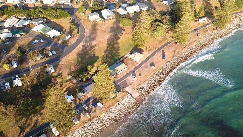 Aerial Drone Above Seaside Town Coastline Beside Sandy Beach And Blue Ocean In Australia | Shutterstock HD Video #1057128110