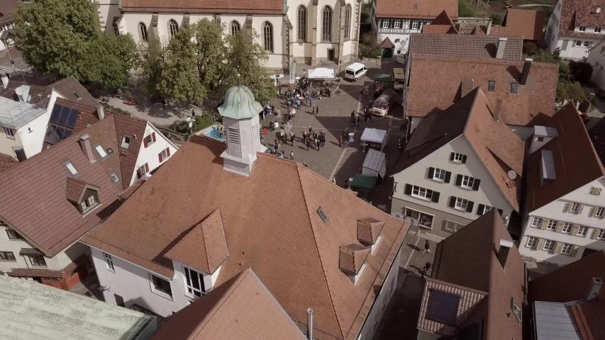 Drone flight Germany in city Weilheim an der Teck - Townhall and church 6of6 | Shutterstock HD Video #1057133558