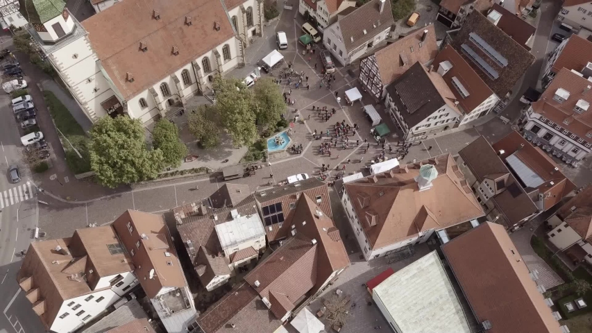Drone flight Germany in city Weilheim an der Teck - Townhall and church  | Shutterstock HD Video #1057133567
