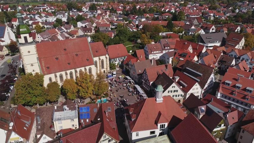 Drone flight in German city Weilheim an der Teck - Church Peterskirche | Shutterstock HD Video #1057133573