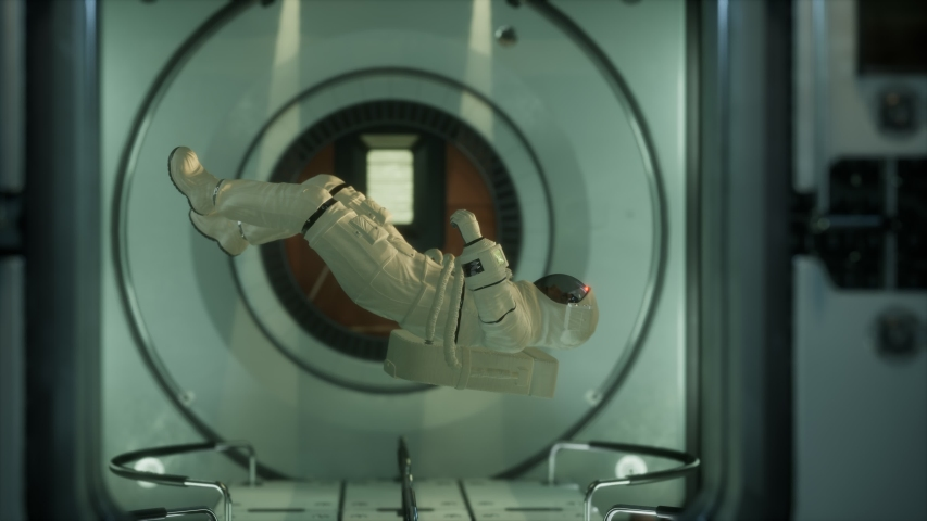 Astronaut inside the orbital space station. Elements of this image furnished by NASA. | Shutterstock HD Video #1057151294