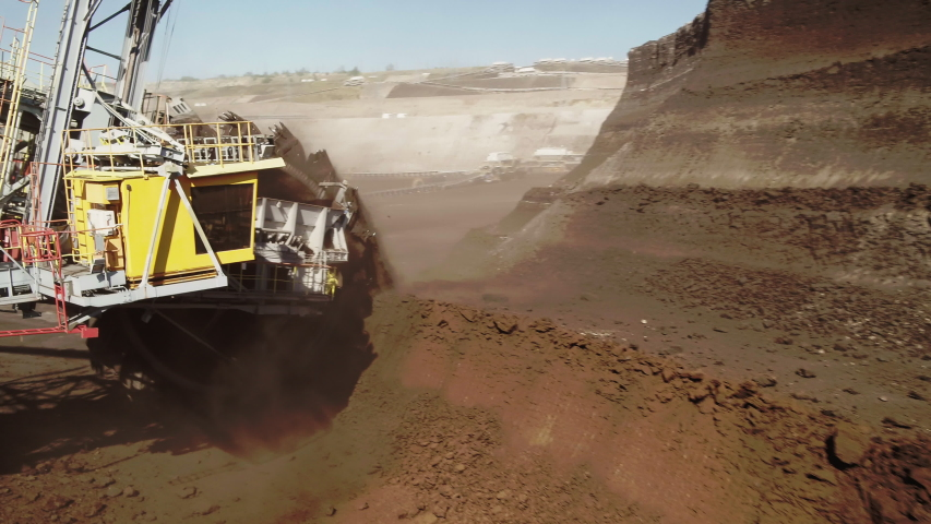 A large bucket-wheel excavator in a lignite (brown-coal) mine aerial view Royalty-Free Stock Footage #1057152716