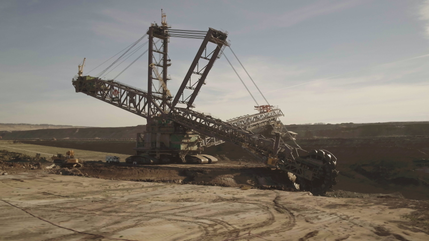 A large bucket-wheel excavator in a lignite (brown-coal) mine aerial view Royalty-Free Stock Footage #1057152719