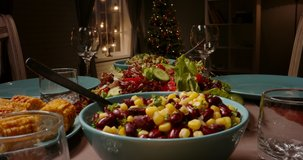 Close up shot of family celebration dinner table served with healthy vegetarian meals. holiday party table during thanksgiving or christmas - food and drink concept 4k footage