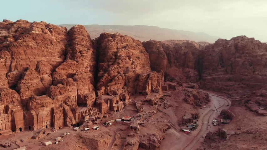 Epic view of the Petra valley in Jordan with its temples in the middle of a rocky and mountaineous landscape, an Unesco heritage site, ancient Nabatean Kingdom
