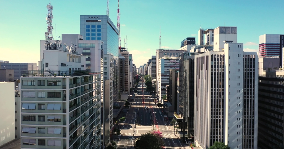 Flying over Paulista avenue during the covid 19 quarantine, empty streets on the financial center of Sao Paulo, Brazil. | Shutterstock HD Video #1057194517