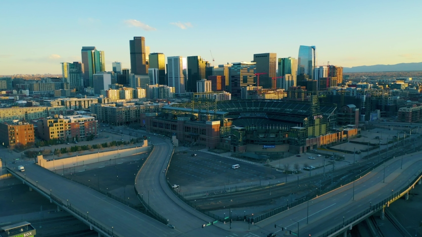 Aerial view of downtown Denver showing empty streets due to covid-19. Global pandemic corona virus. Denver skyline and Coors Field.