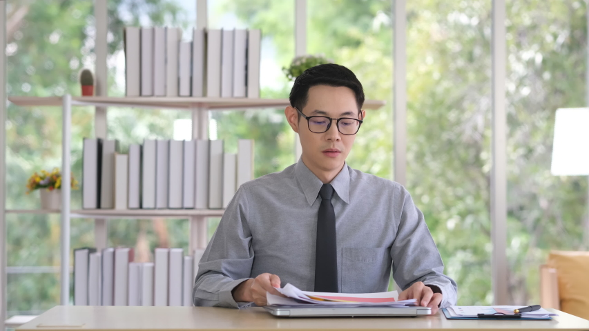 Office workers who are dissatisfied with their work. The boss is upset after the job check. The boss threw the paper because he was dissatisfied with the result. | Shutterstock HD Video #1057207159