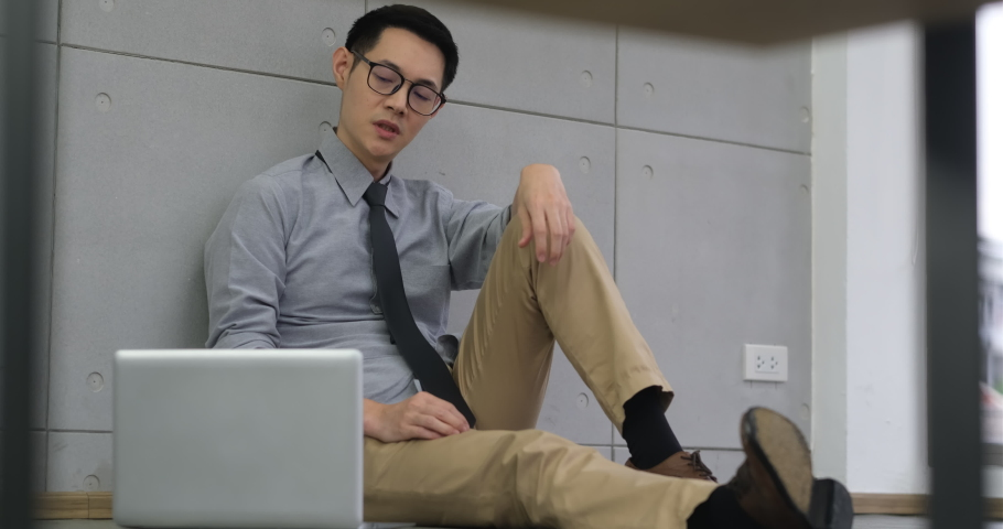 The office worker was dismissal. An office worker who was stressed and cried because of dismissal. An office worker reading a letter of dismissal. business man feel sad about his job. | Shutterstock HD Video #1057207723