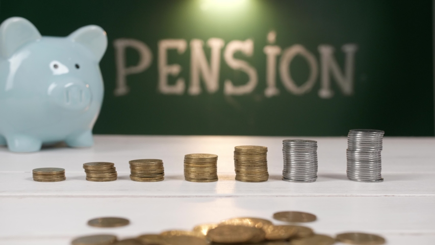 Composition with stacked coins and word PENSION on table | Shutterstock HD Video #1057214986