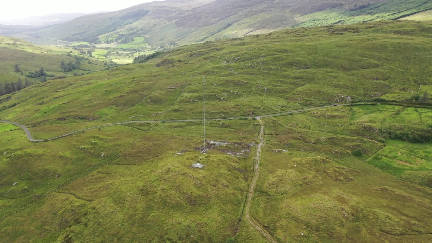 Aerial view of transmitter tower on an agricultural field in the irish highlands by Glenties in County Donegal.   Shutterstock HD Video #1057220860