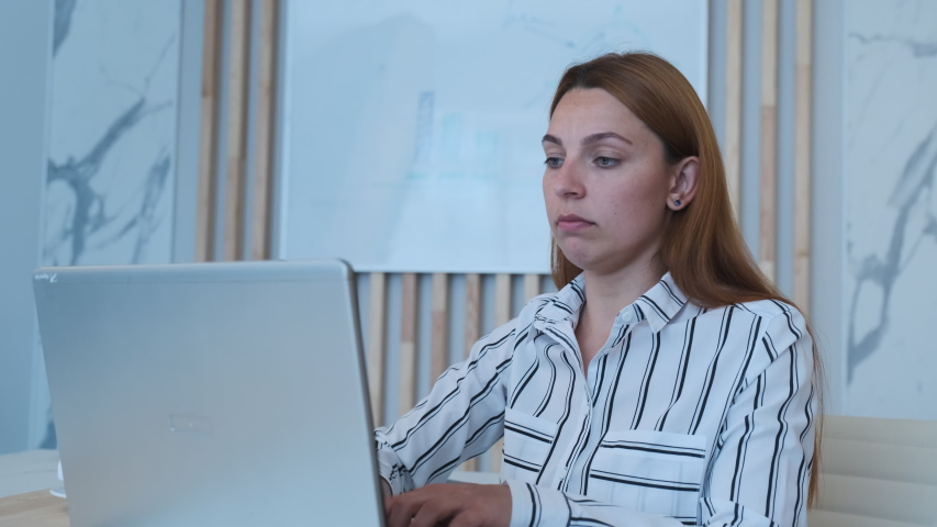 Young business woman using laptop sit at office
