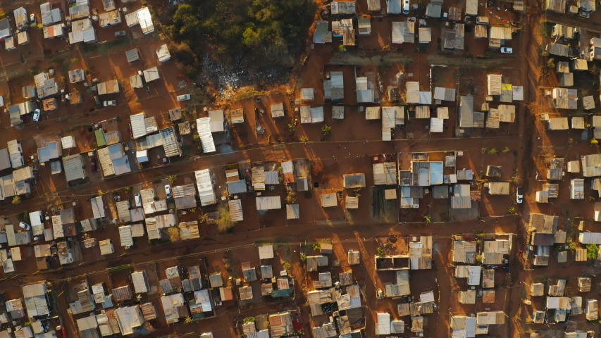 Poverty.Inequality.Straight down aerial view of the densly over crowded and populated Mamelodi African township(squatter camp), South Africa Royalty-Free Stock Footage #1057238644