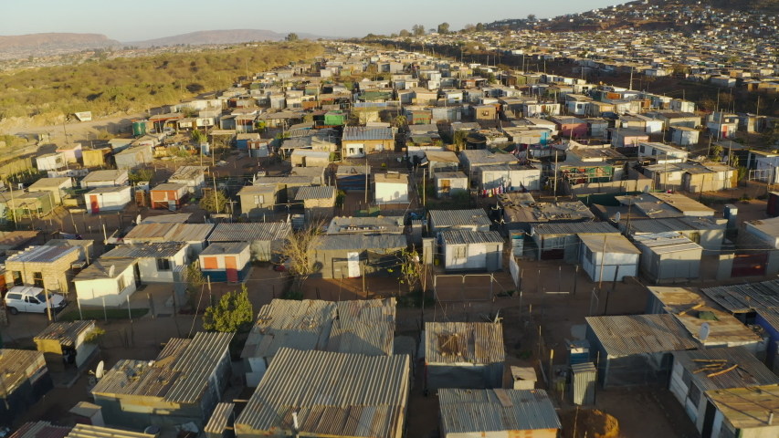 Close-up aerial fly over view of the densly over crowded and populated Mamelodi African township(squatter camp), South Africa Royalty-Free Stock Footage #1057238668