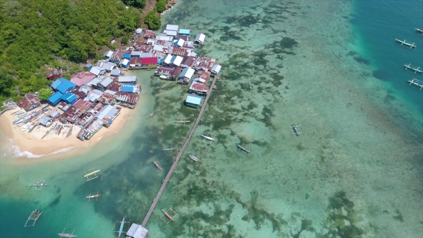Aerial View of White Sandy Beach Fishing Village, Jayapura Papua Indonesia, Asia | Shutterstock HD Video #1057240141