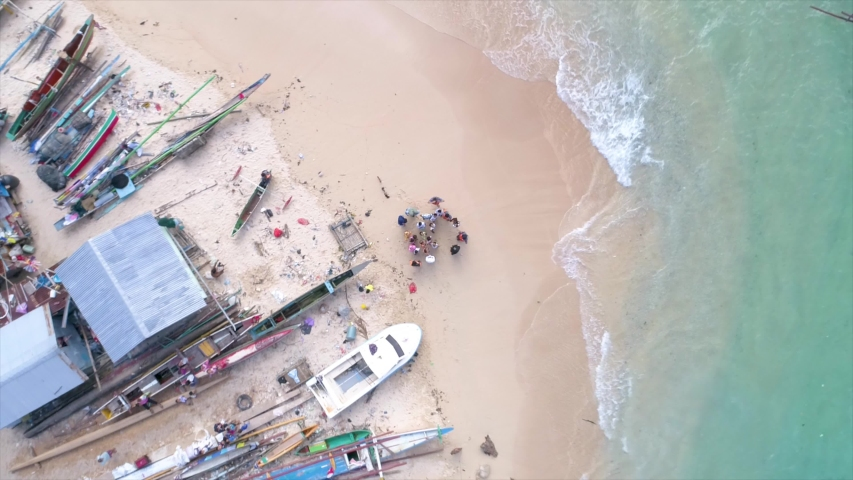Aerial View of White Sandy Beach Fishing Village, Jayapura Papua Indonesia, Asia | Shutterstock HD Video #1057240147