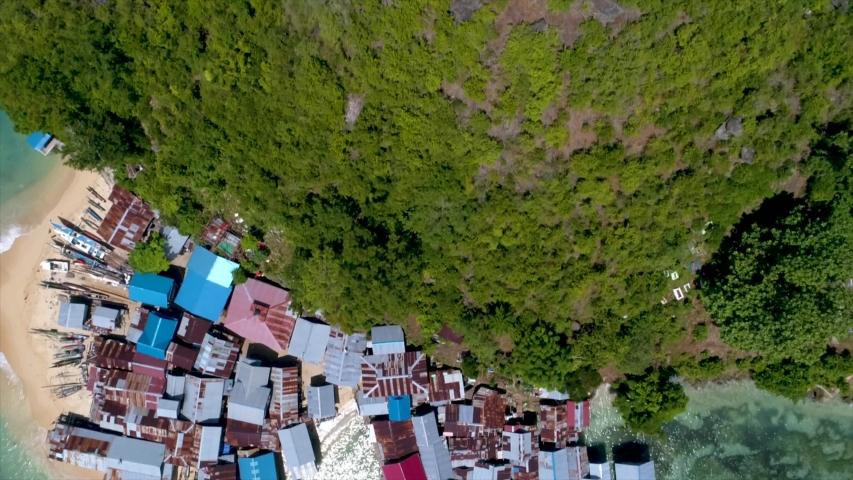 Aerial View of White Sandy Beach Fishing Village, Jayapura Papua Indonesia, Asia | Shutterstock HD Video #1057240153