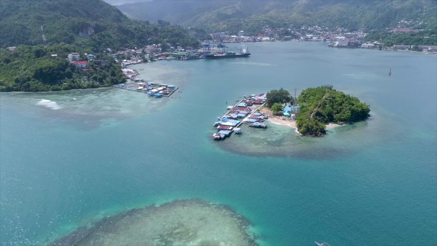Aerial View of Tropical Island and Blue Ocean in Jayapura Papua Indonesia, Asia | Shutterstock HD Video #1057240168