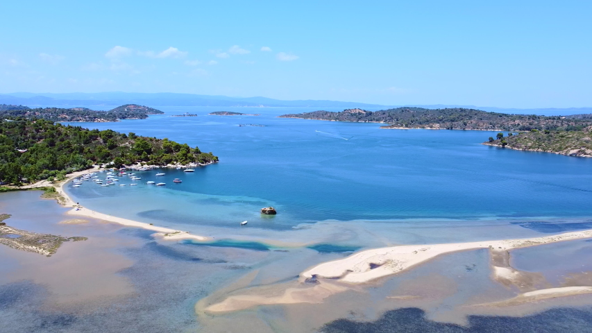 Amazing blue lagoon with white sand beaches , blue sea and boats on the sea. Aerial view  | Shutterstock HD Video #1057243981