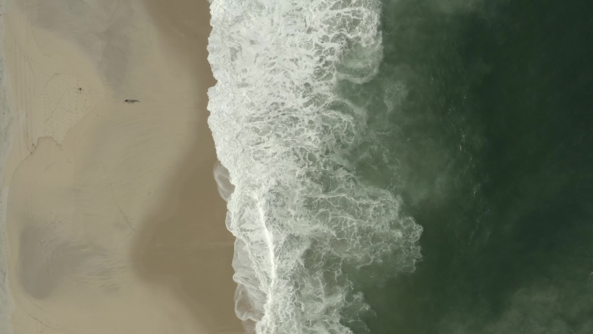 Aerial view of a man fishing in the ocean.  | Shutterstock HD Video #1057245178