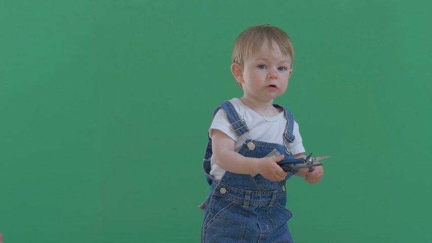 Little baby child with worker overall hold screw driver, green screen   Shutterstock HD Video #1057247785