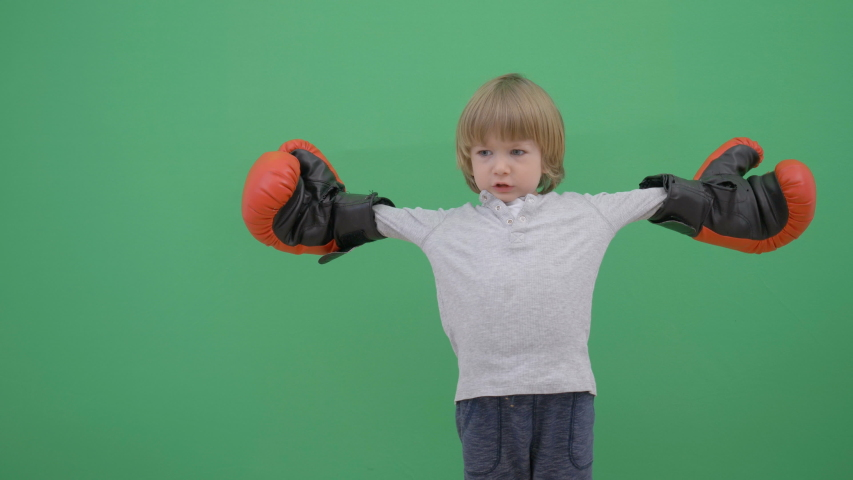 Little child with red gloves prepare for fight, green screen   Shutterstock HD Video #1057247788