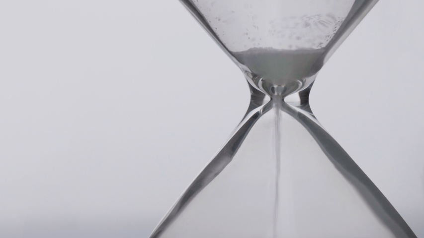 Close-up detail of sand pouring in hourglass, time pass concept, deadline end | Shutterstock HD Video #1057247860