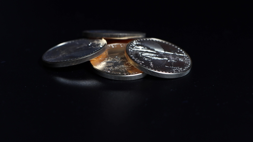 Five gold dollar coins with a value of 10000 dollars lie on a turntable | Shutterstock HD Video #1057248580