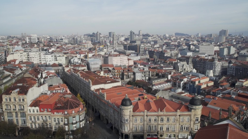 Aerial view of Porto old town rooftops on a cloudy day, sideways shot | Shutterstock HD Video #1057257889