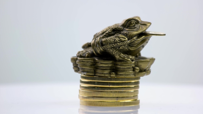 Frog sitting on a top of coins pile. Financial growth, business, money and prosperity concept. | Shutterstock HD Video #1057284175