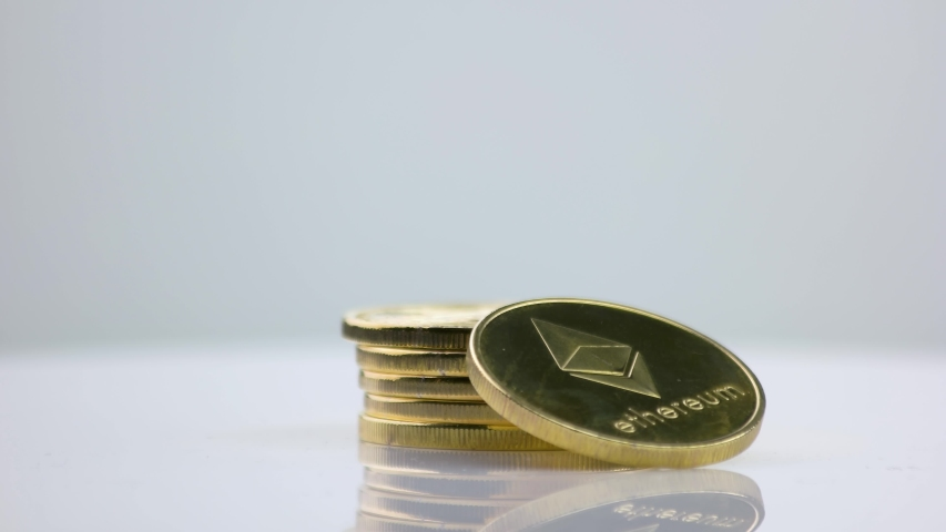 Close up stack of golden ethereum coins. Crypto-currency ETH. Business, money, e-banking and trading concept. | Shutterstock HD Video #1057284229
