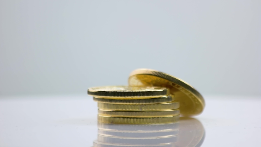Golden litecoins stacked on gray background. Litecoin digital money. Cryptocurrency trading, e-banking. | Shutterstock HD Video #1057284232
