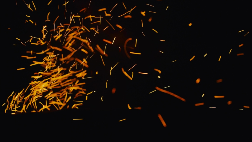 Burning red hot sparks rise from fire in the night sky   Shutterstock HD Video #1057285993
